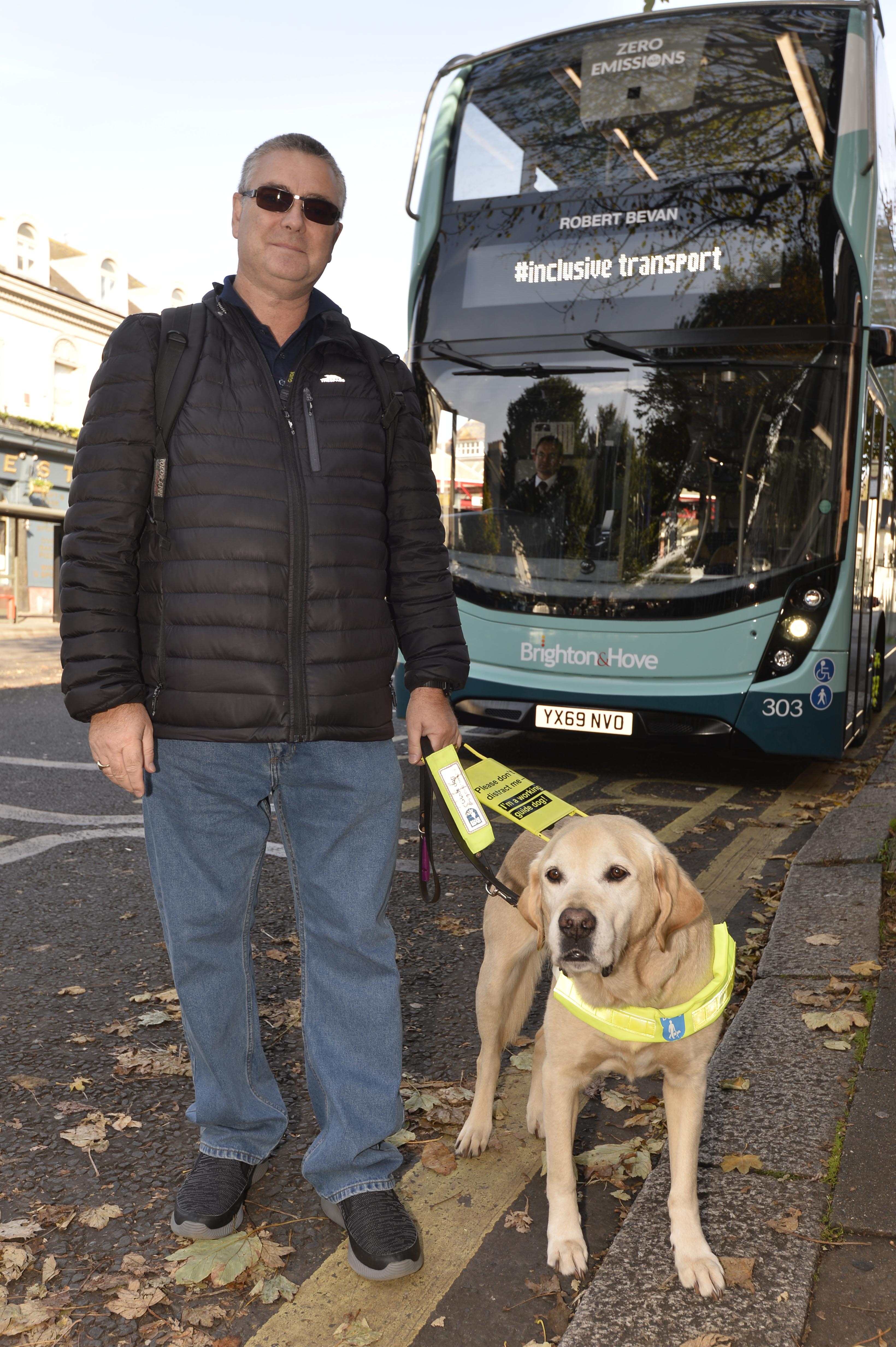 An image of Graham and a guide dog.